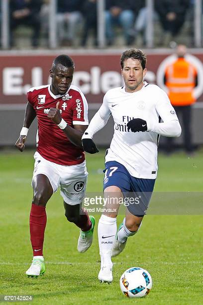 Fallou Diagne of Metz and Maxwell of PSG during the Ligue 1 match between Fc Metz and Paris SaintGermain at Stade SaintSymphorien on April 18 2017 in...