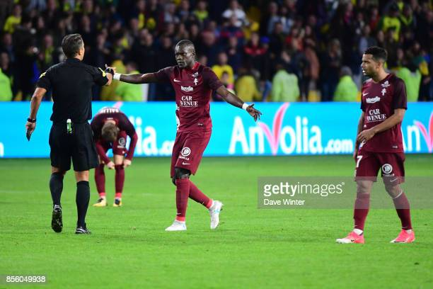 Fallou Diagne of Metz complains to referee Johan Hamel after his side lose the Ligue 1 match between Nantes and Metz at Stade de la Beaujoire on...