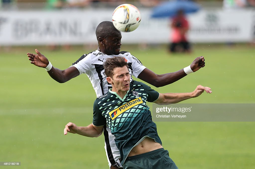 Fallou Diagne of Stade Rennes and Branimir Hrgota of Borussia Moenchengladbach battle for the ball during the friendly match between Stade Rennes and Borussia Moenchengladbach at Sportpark Heimstetten on July 18, 2015 in Heimstetten, Germany.