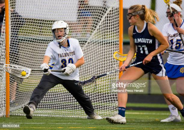 Falmouth goalie Mary Budri makes a save as Yarmouths Stella Antolini is out front during girls lacrosse action at Falmouth High School on Friday June...