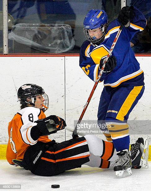 Falmouth's Sarah Hutcheon right tries to untangle herself from Biddeford's Dalani Roy during a girls ice hockey game at Biddeford Ice Arena Saturday...