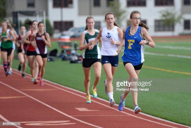 Falmouth's Sofie Matson leads the way during the SMAA relays at Thornton Academy Thursday August 31 2017 She is followed by Quincey Lyden of...