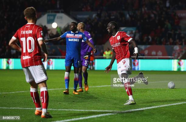 Famara Diedhiou of Bristol City celebrates scoring his sides first goal during the Carabao Cup Third Round match between Bristol City and Stoke City...