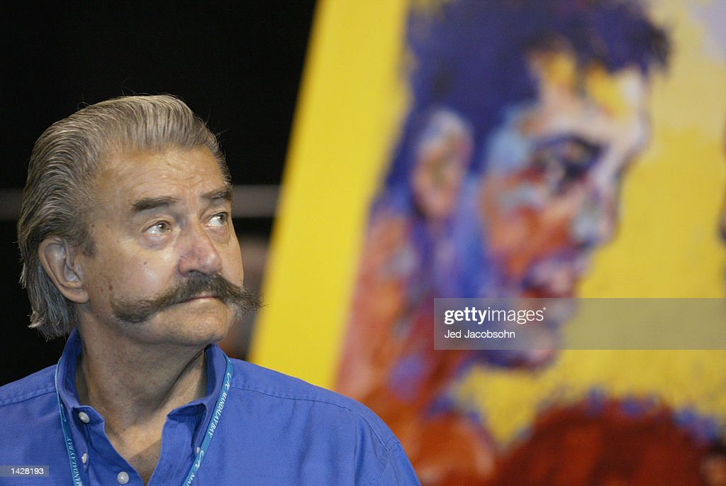 Famed artist Leroy Neiman looks on during weigh-ins for the World Super Welterweight/Jr. Middleweight Championship fight between Oscar De La Hoya and Fernando Vargas at the Mandalay Bay Events Center on September 13, 2002 in Las Vegas, Nevada. Neiman's painting of the fighters shows Oscar De La Hoya is in the background.