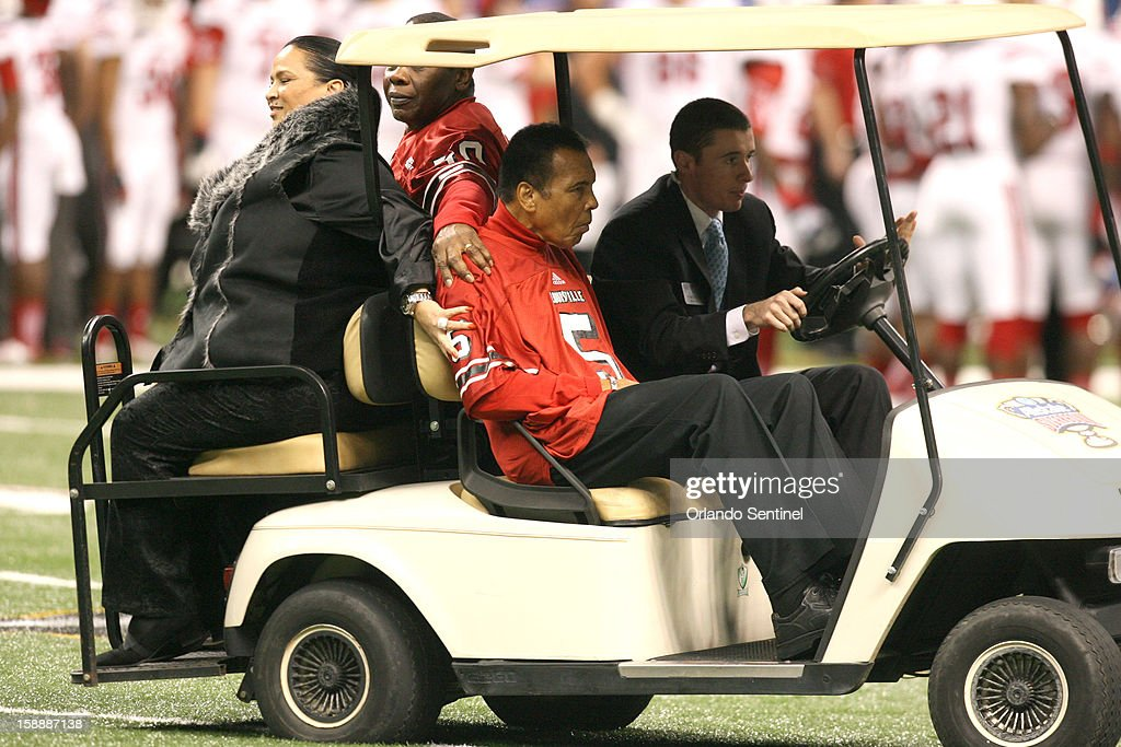 Famed boxer Muhammad Ali leaves the field before the start of the Allstate Sugar Bowl between Florida and Louisville at the Mercedes-Benz Superdome on Wednesday, January 2, 2013, in New Orleans, Louisiana.