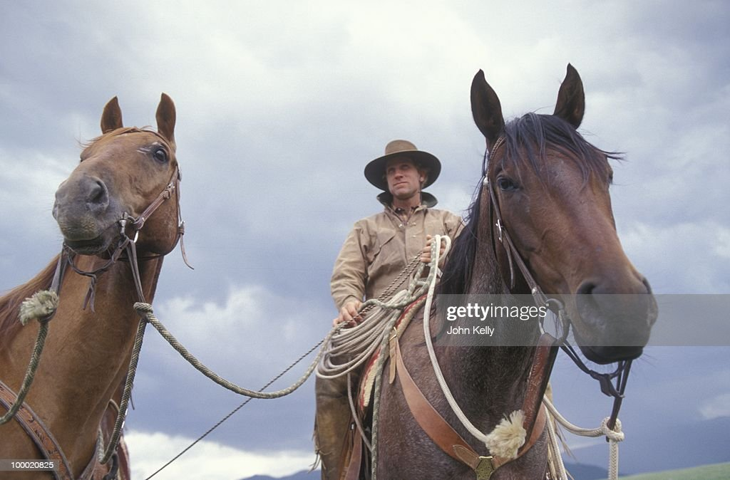Famed horse trainer Buck Brannaman stands by with his horses during the filming of 'The Horse Whisperer' in 1997.
