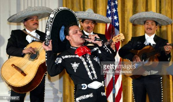 Famed Mexican singer Pedro Fernandez (C) sings with his ...