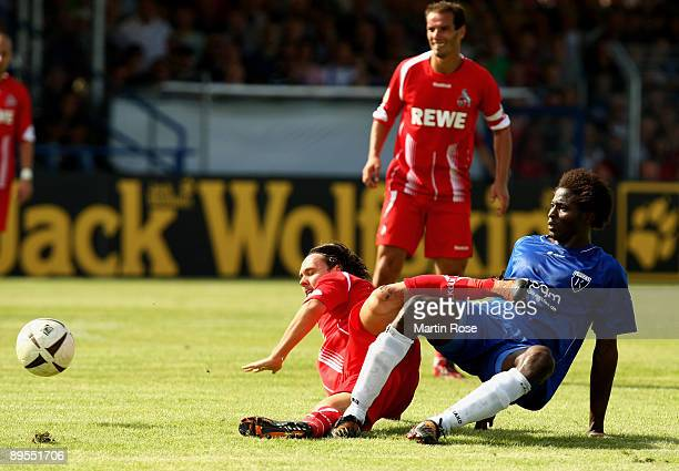 Famewo of Emden and Maniche of Koeln battlle for the ball during the DFB Cup first round match between BSV Kickers Emden and 1 FC Koeln at the...