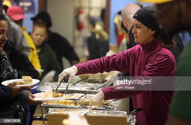 Families affected by Superstorm Sandy receive a hot lunch on November 8 2012 in the Brooklyn borough of New York City Food and blankets were...