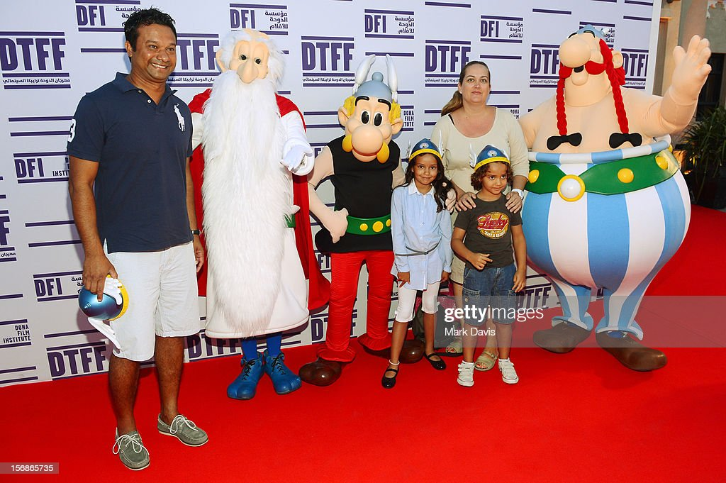 Families and Children pose with Asterix, Obelix and Getafixat attend the 'Asterix and Obelix 3D' Premiere during the 2012 Doha Tribeca Film Festival at o n November 23, 2012 in Doha, Qatar.
