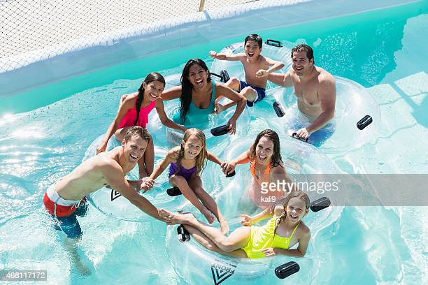 Families and friends at water park on lazy river