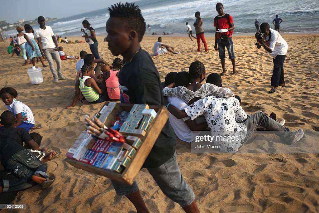 Families and friends enjoy 'Miami Beach' on January 25 2015 in Monrovia Liberia With Ebola cases now in single digits nationwide many Liberians have...