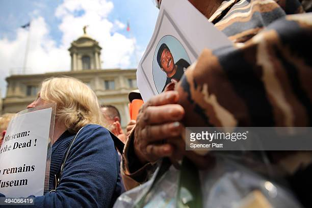 Families and friends of some of those killed on 9/11 and never found attend a news conference on the steps of City Hall to criticize the placement of...