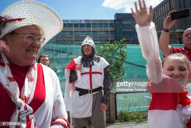 Families and local residents watch the Manchester St George's Day parade through the streets on April 23 2017 in Manchester England Various parades...