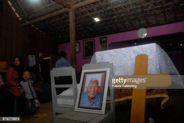 Families and relatives attend the funeral ceremony of Mbah Gotho an Indonesian man who claimed to be the oldest human in world's history in Sragen on...