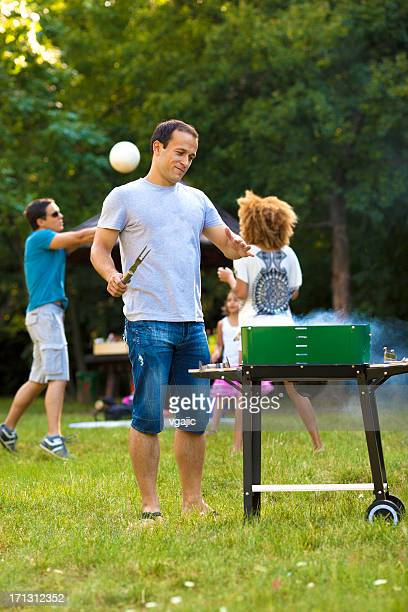 Families at barbecue picnic.
