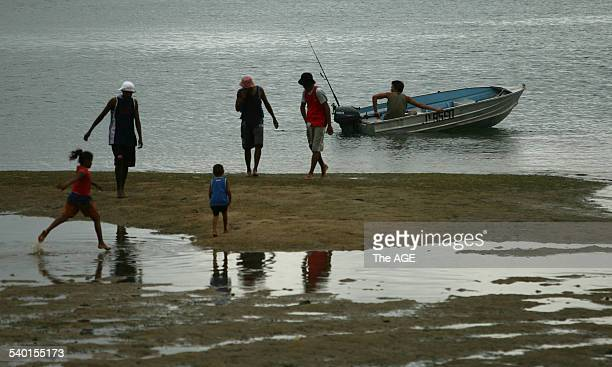 Families at the beach at low tide on Palm Island in northern Queensland 18 January 2007 THE AGE Picture by PAUL HARRIS