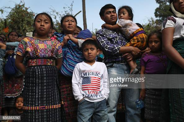 Families attend a memorial service for two boys who were kidnapped and killed on February 14 2017 in San Juan Sacatepequez Guatemala More than 2000...