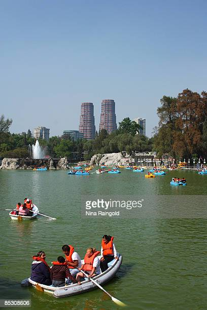 Families boating on the lake at the Bosque de Chapultepec on February 15 2009 in Mexico City Mexico With an estimated population of more that 22...