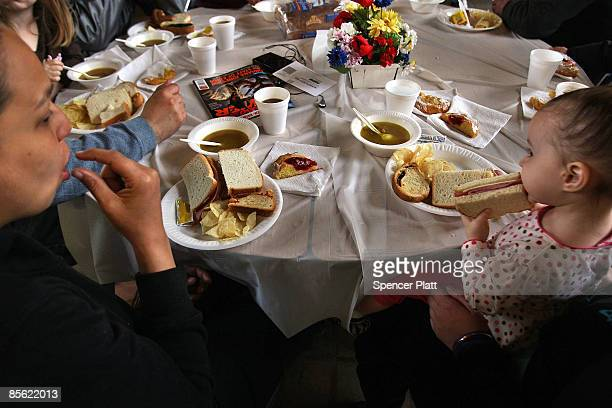 Families eat lunch at a soup kitchen in a church March 26 2009 in Waterbury Connecticut Waterbury a small working class city situated in one of the...