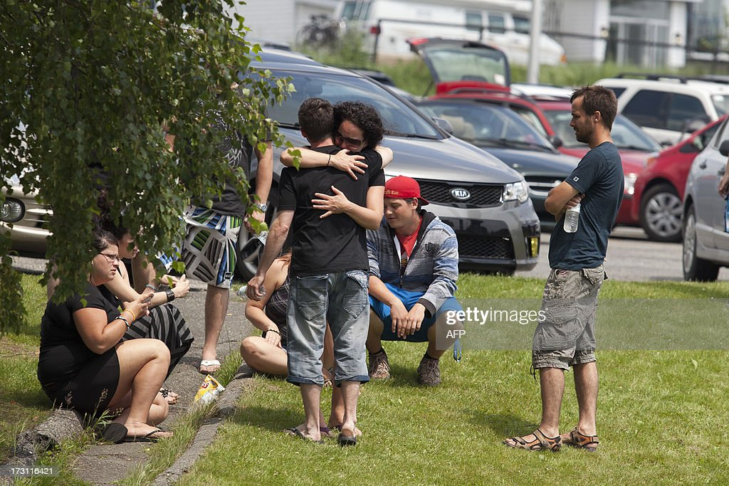 Families embrace in the emergency camp set up at LacMégantic high school on July 7 2013 in LacMegantic Quebec Canada one day after a train derailment...