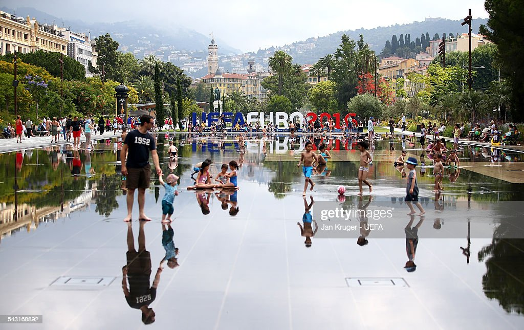 Families enjoy playing in a water fountain ahead of the UEFA EURO 2016 round of 16 match between England and Iceland at Allianz Riviera Stadium on June 26, 2016 in Nice, France.