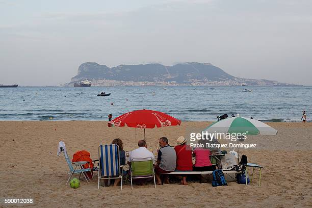 Families enjoy the meals and drinks during the yearly Virgin of Palm maritime pilgrimage at El Rinconcillo beach on August 15 2016 in Algeciras Spain...