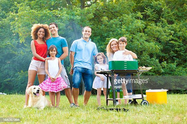 Families enjoying a barbecue.