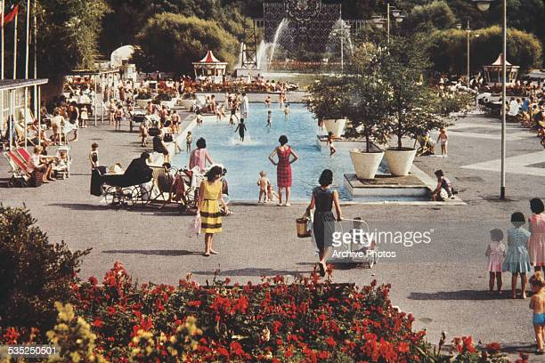 Families enjoying Battersea Park Lido London circa 1960