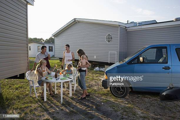 Families enjoying lunch in front of trailer home