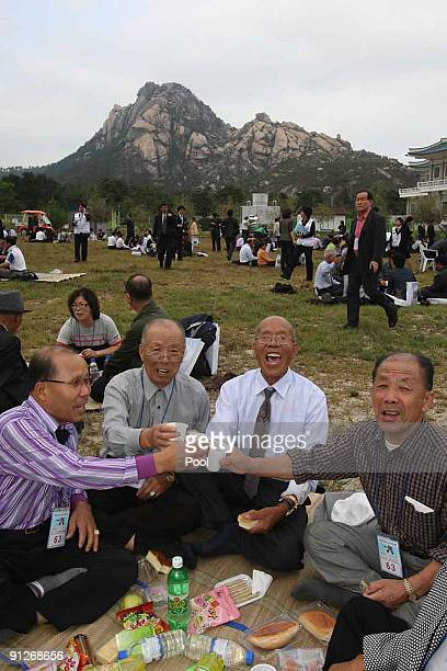 Families from North and South Korea who were separated by the Korean War are reunited with long lost relatives at the Mount Kumgang resort on...