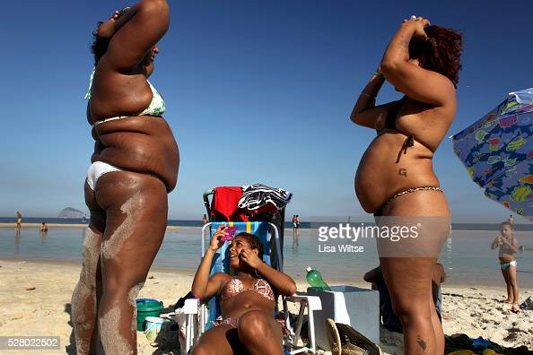 Families from the nearby favelas spending the afternoon on Sao Conrado beach where the high tide left pools of water on July 12 2010 Photo by Lisa...
