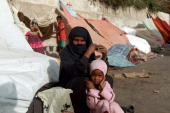 Families from the northern Yemeni city of Amran 50 kilometres north of Sanaa take refugee in the capital on July 13 2014 after fleeing their home as...