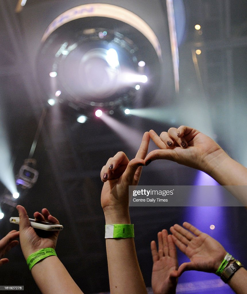 Families in the crowd make diamonds with their hands in the final hour of the Penn State IFC/Panhellenic Dance Marathon in State College, Pennsylvania, Sunday, February 17, 2013.