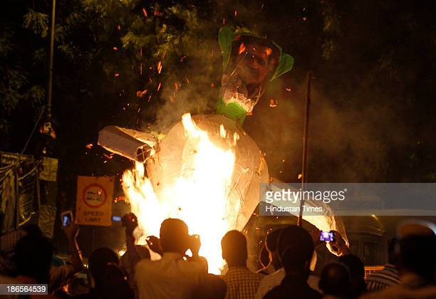 Families of 1984 AntiSikh riots victims burn effigy of Congress leader Sajjan Kumar and Jagdish Tytler during the protest demanding justice at Jantar...