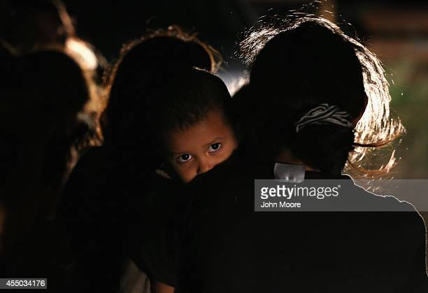 Families of Central American immigrants including Jamie Gonzales and her son Jose Manuel from El Salvador turn themselves in to US Border Patrol...