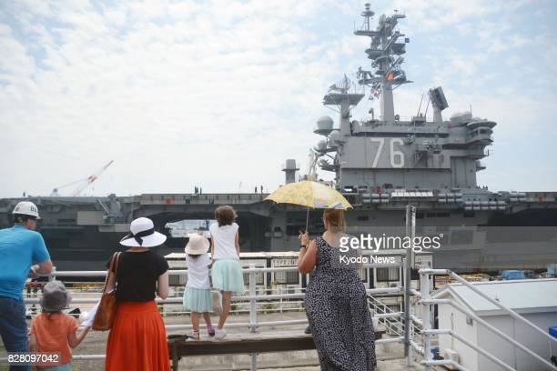 Families of crew members welcome the return of the US aircraft carrier Ronald Reagan at the US Yokosuka Naval Base in Kanagawa Prefecture south of...