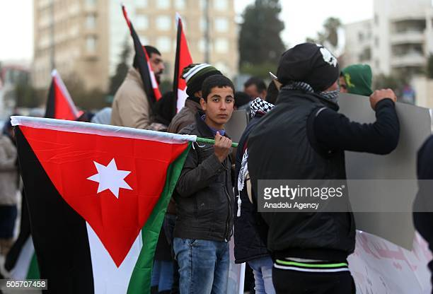Families of Jordanian prisoners in Israel hold national flags during a demonstration demanding release of Jordanian prisoners in Amman Jordan on...