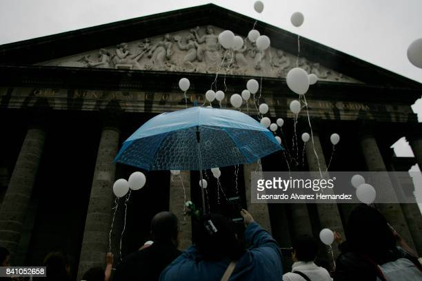 Families of missing persons let white loose balloons during a protest to demand the authorities theresolution of the forced dissapearance cases as...