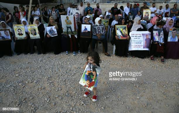 Families of Palestinians imprisoned in Israeli jails demonstrate in front of the Red Cross offices in east Jerusalem on May 17 as hundreds of the...