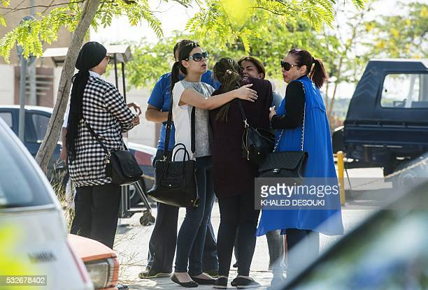 Families of passengers who were flying on board an EgyptAir plane that vanished from radar en route from Paris to Cairo react as they wait outside a...