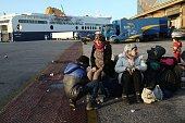 Families of refugees and migrants wait in the port of Piraeus after their arrival aboard the Blue Star 1 passenger ship early on March 3 2016 580...