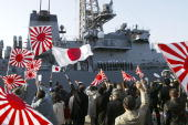 Families of the Japanese Self Defence Force see off the Japanese support vessel 'Murasame' sailing to Muroran Japan on a mission to protect the...