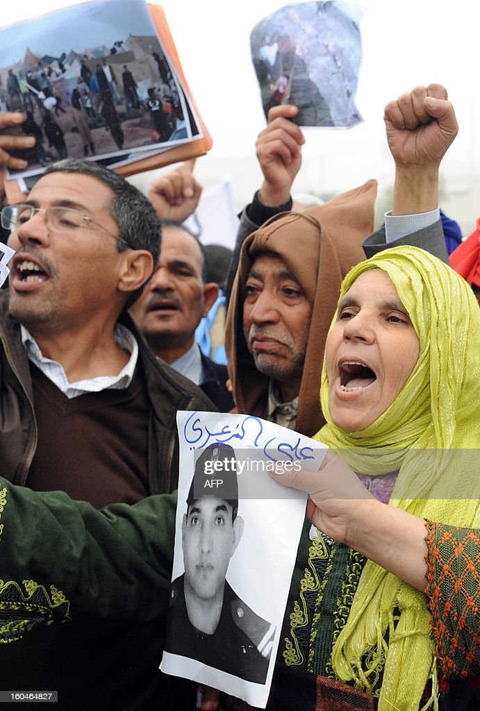 Families of the security forces who were killed in 2010 during clashes with Sahrawis, demonstrate in front of the court in Rabat, on February 1, 2013. Rival protests were held outside a military tribunal in the Moroccan capital where 24 Sahrawis accused of killing members of the security forces in the Western Sahara in 2010 are being tried.