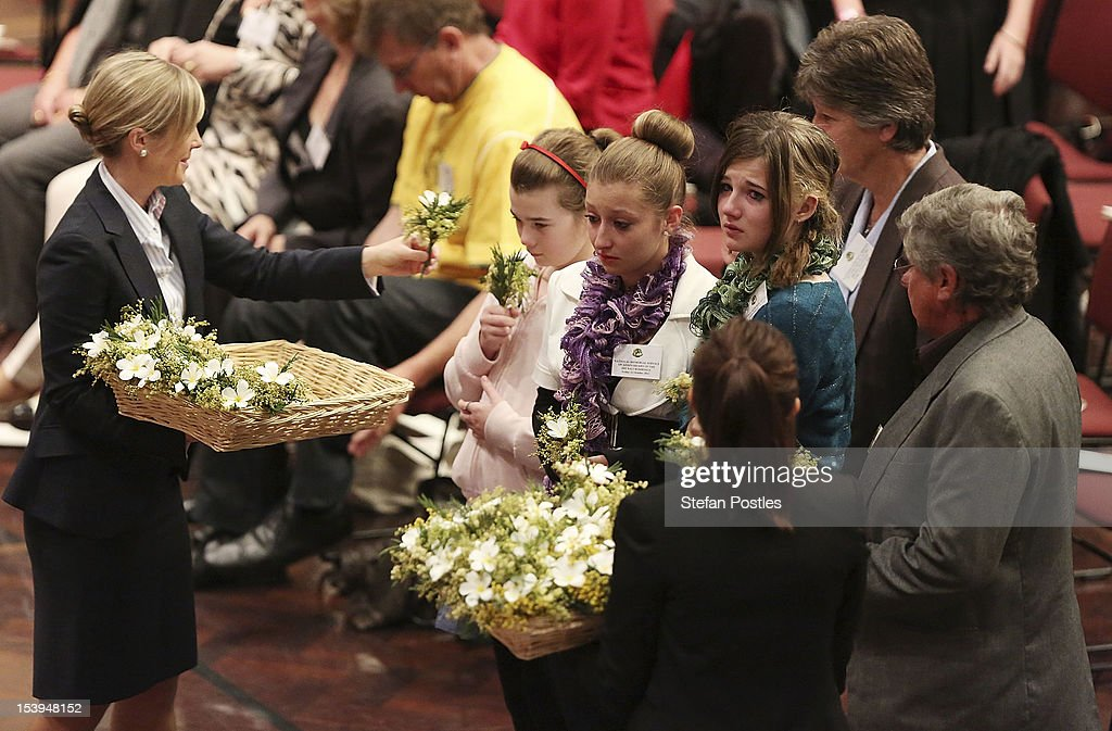 Families of the victims receive flowers to place on the National Memorial Wreath at the National Memorial Service held at Parliament House on October 12, 2012 in Canberra, Australia. The ceremony marks tenth anniversary of the 2002 Bali suicide bombs that killed 202 people including 88 Australians.