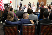 Families of victims of the Orlando nightclub shooting look on as democratic presidential candidate former Secretary of State Hillary Clinton speaks...