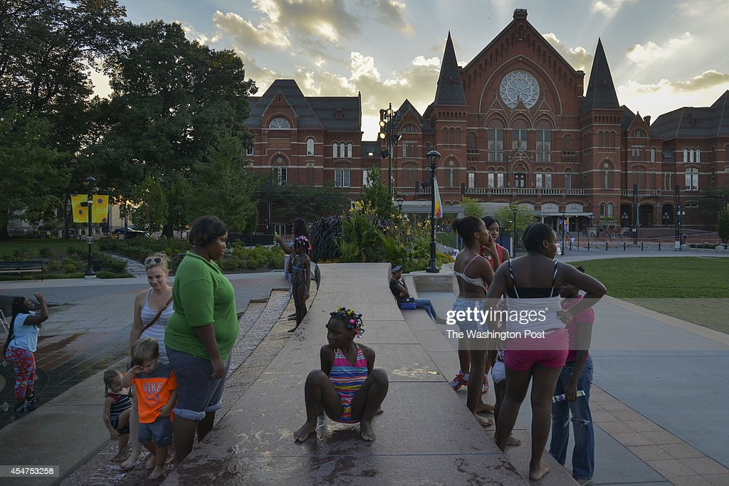 Families play in the fountains of Washington Park in the Over theRhine neighborhood on Wednesday September 3 in Cincinnati OH The recently renovated...