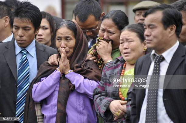Families react as the Union Flag draped coffins containing the bodies of Sapper Darren Foster of 21 Engineer Regiment and Sapper Ishwor Gurung of 36...