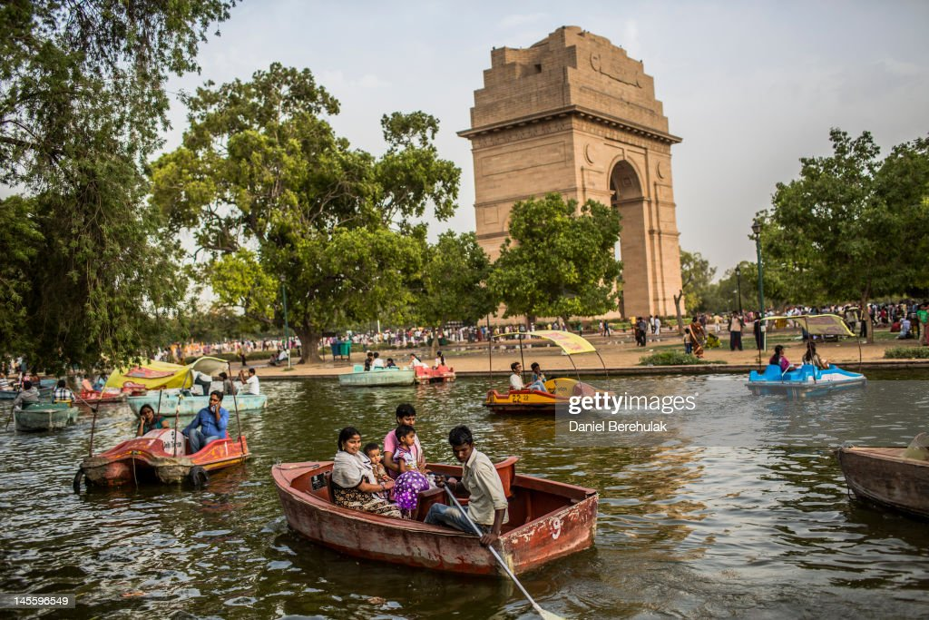 Families take boat rides in a pond at the India Gate monument on June 2 2012 in New Delhi India A heat wave continues across the Northern India...