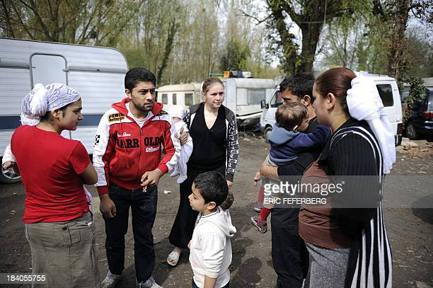 Families talk together near caravans on April 5 2011 in the MoulinGalant camp in CorbeilEssonnes outside Paris where about 70 Roma families live AFP...